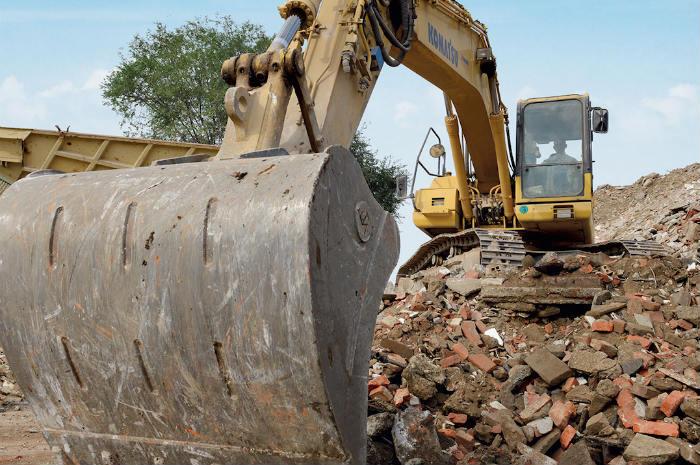 Risultati immagini per ruspa demolizione casa